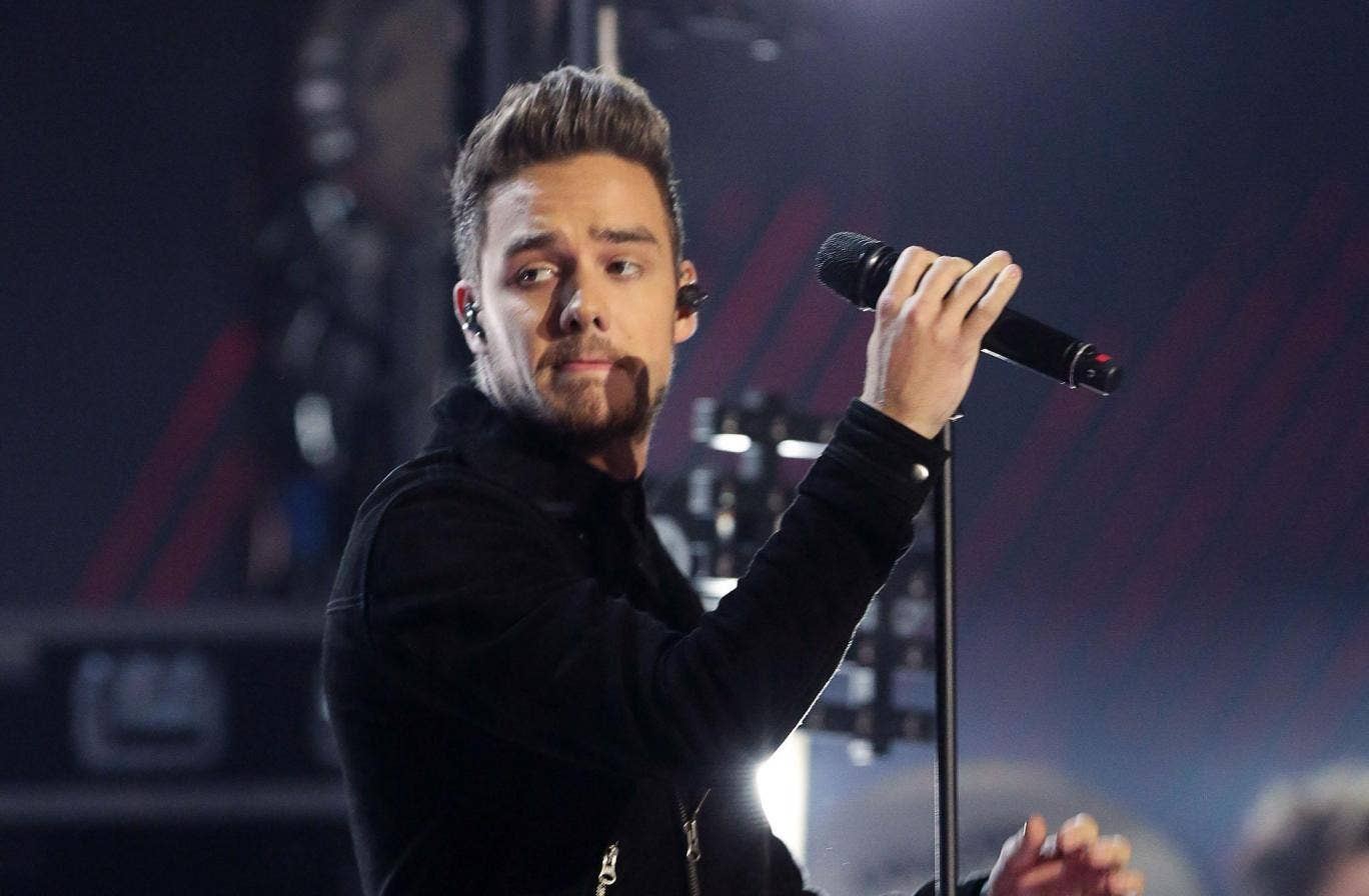 One Direction star Liam Payne was forced to apologise to fans last night after he posted a picture of himself dangerously balanced on the roof ledge of a 34-floor building
