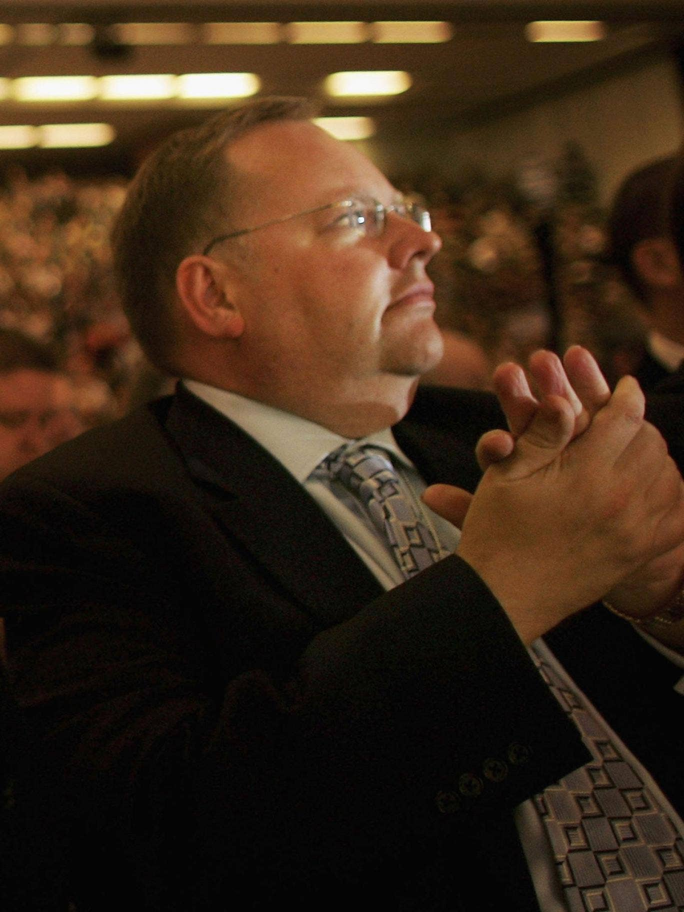 Lord Rennard applauds former leader of the Liberal Democrats, Charles Kennedy during his speech to delegates in 2006.