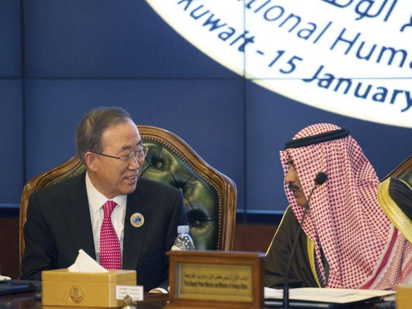 United Nations Secretary General Ban Ki-Moon talks to Kuwait's Minister of Foreign Affairs Sheikh Sabah alKhalid AlSabah at the end of the Second International Humanitarian Pledging Conference for Syria at Bayan Palace in Kuwait January 15, 2014
