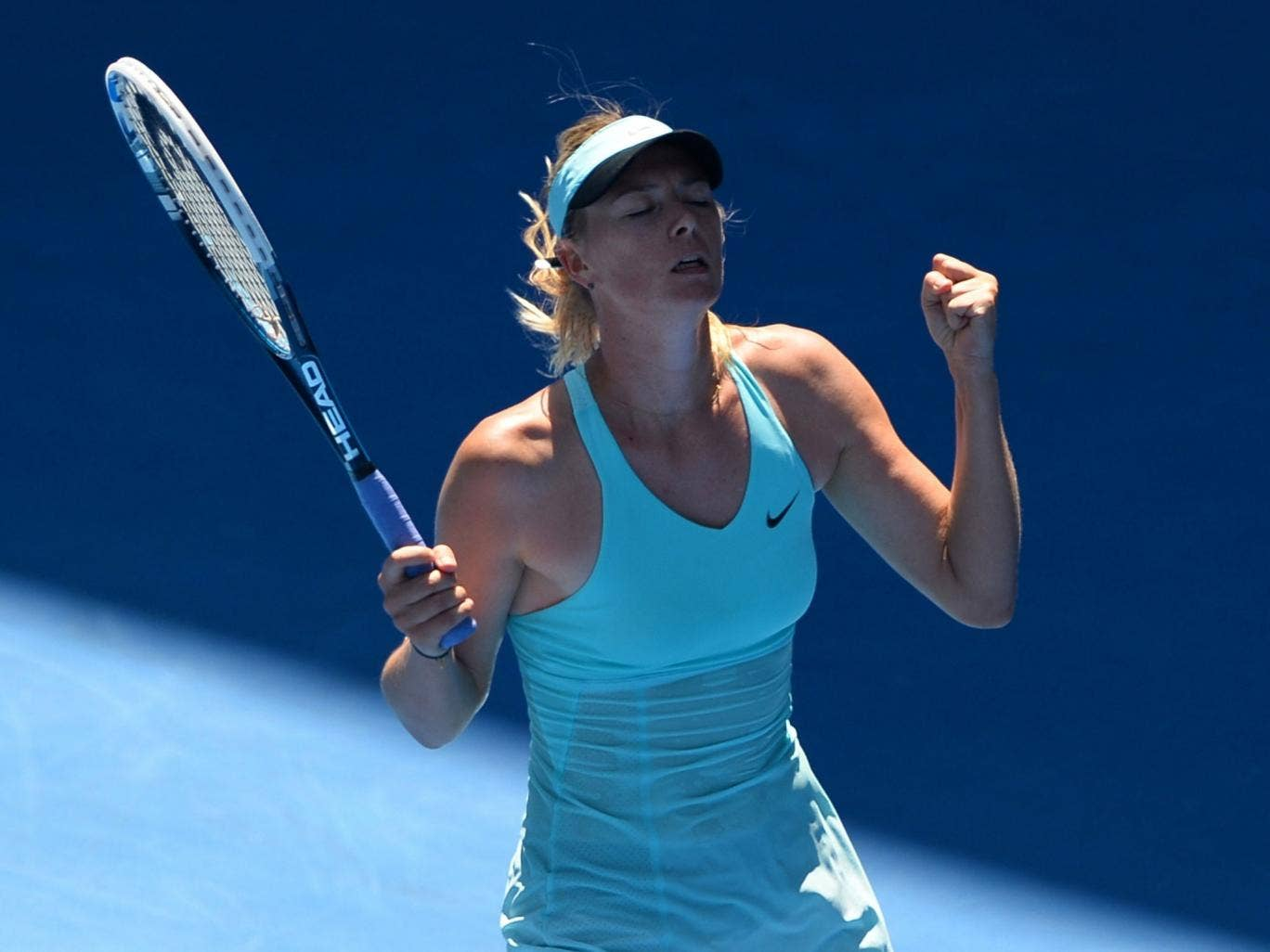 Maria Sharapova celebrates her victory over Karin Knapp in the Australian Open second round
