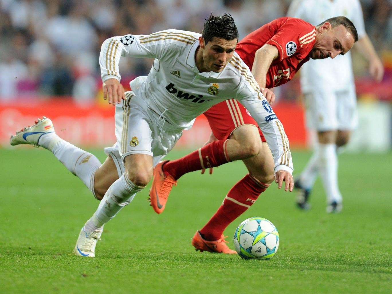 Cristiano Ronaldo and Franck Ribery jostle for the ball during Real Madrid's match against Bayern Munich