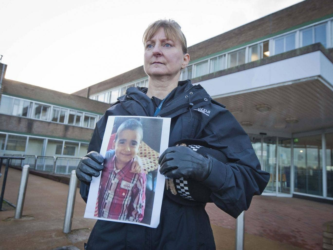 Superintendent Liz McCainsh holds a photo of missing 3-year-old boy Mikaeel Kular who was last seen going to bed at his family's flat, at around 9pm and was discovered missing from his bed by his mother at around 7.15am when the family woke up