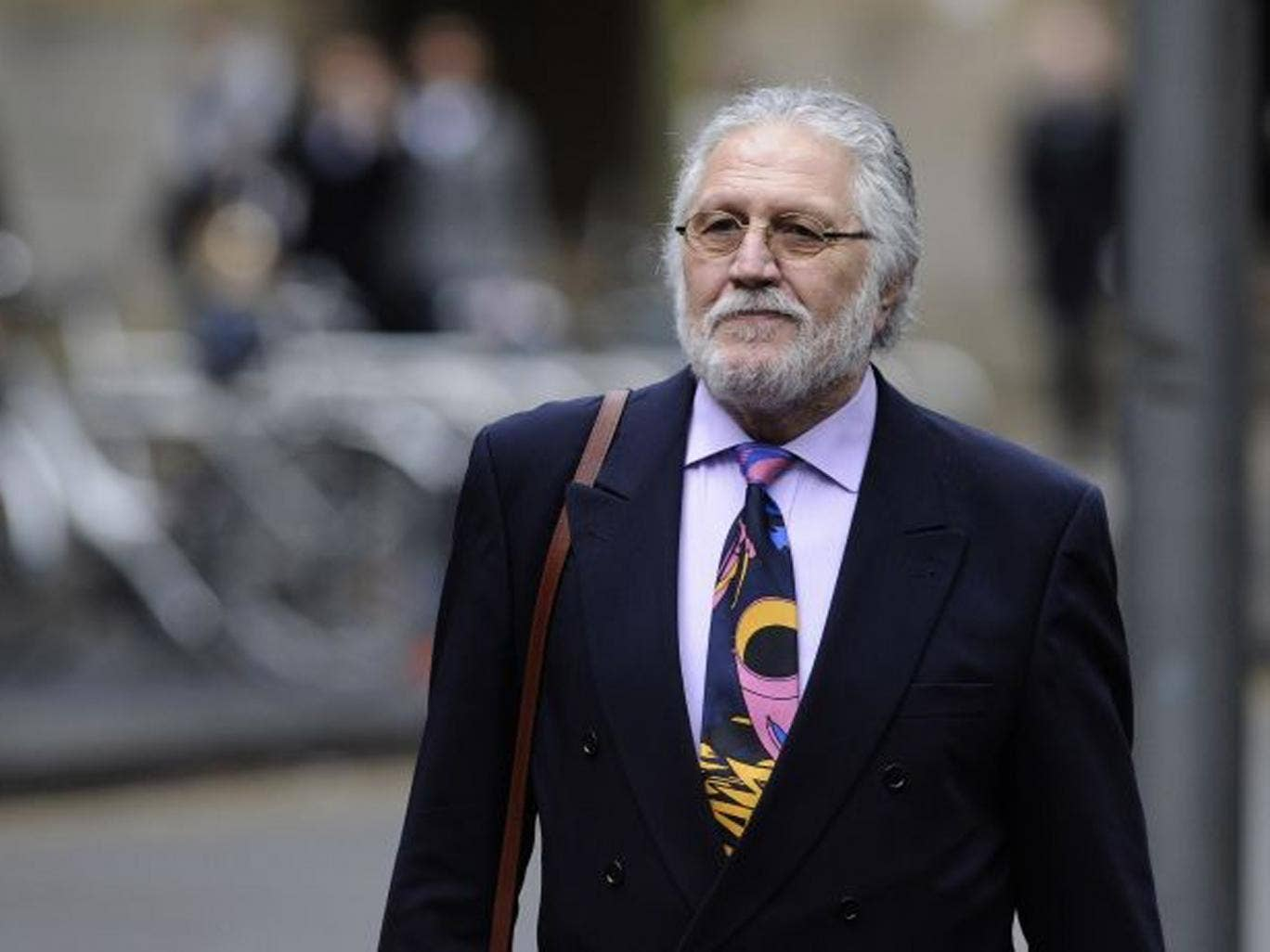 Dave Lee Travis, whose real name is David Patrick Griffin, arrives at Southwark Crown Court on 17 January 17 2014