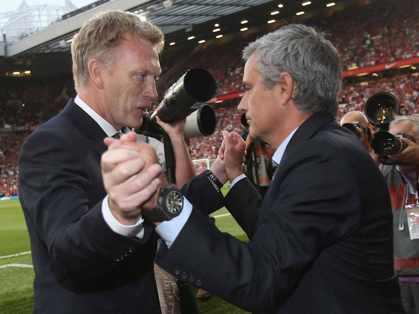 David Moyes and Jose Mourinho shake hands ahead of the goalless draw between Manchester United and Chelsea at Old Trafford in August 2013