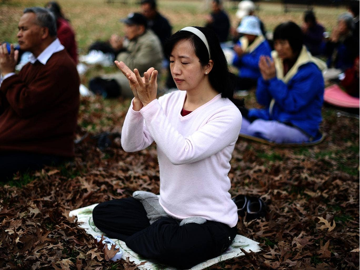 Members of Falun Gong spiritual movement meditate at the Lafayette Park. A new study has suggested that spiritual activity such as meditation may hep prevent depression by thickening the brain cortex