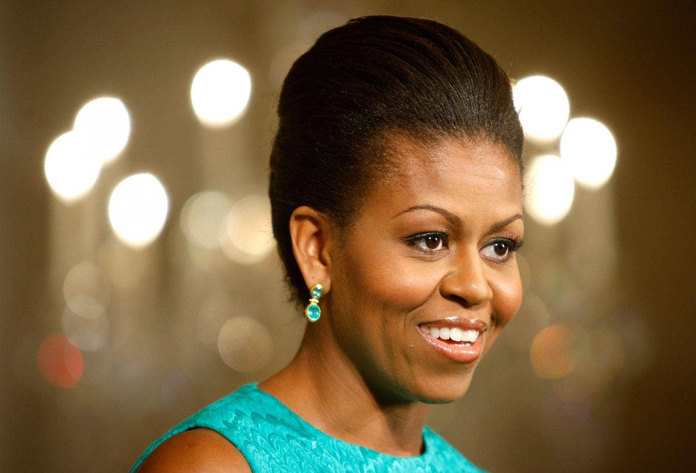 No, we're not sure we entirely believe her. But you've got to admire Michelle Obama's carefree attitude to turning 'the big 5-0'.