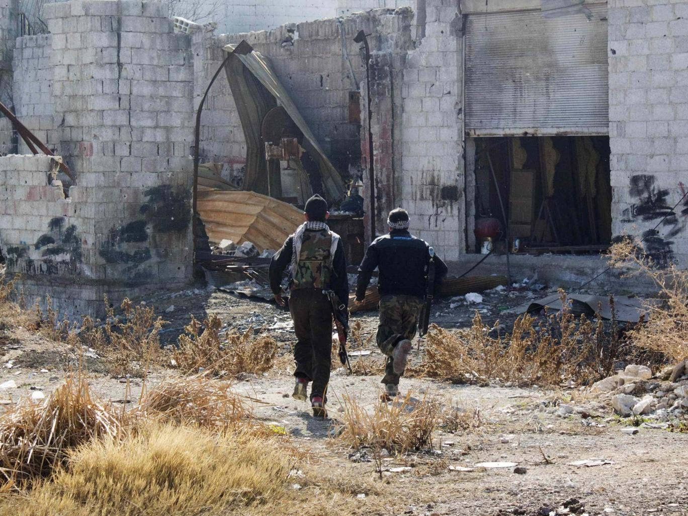 Free Syrian Army fighters carry their weapons as they run for cover in Daraya, near Damascus; Syamend Farhan says he is just happy to have escaped the terror of Syria