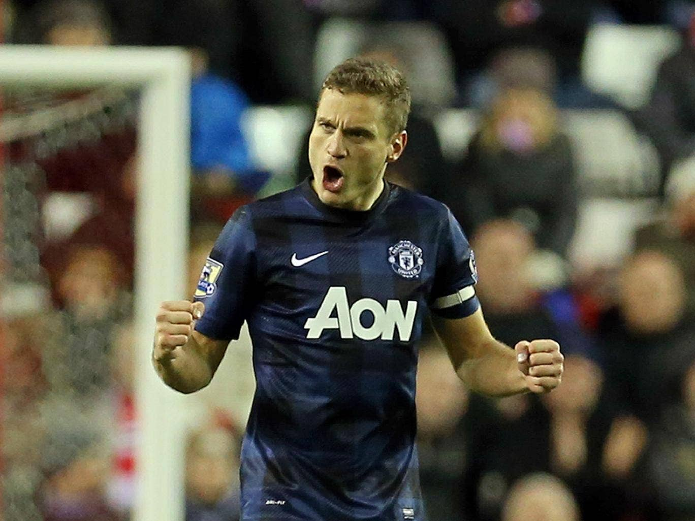 Nemanja Vidic has claimed he will not give up on Manchester United's title chances