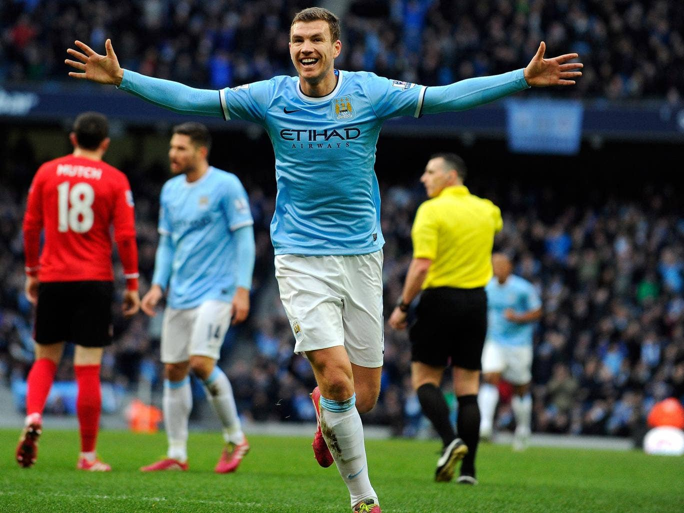 Manchester City striker Edin Dzeko celebrates after scoring their 100th goal of the season in the win over Cardiff