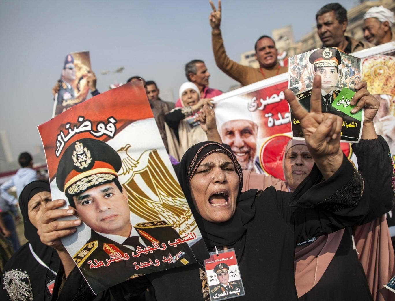 Supporters of Egypt's military chief Abdel Fattah al-Sisi hold his portrait on November 19, 2013