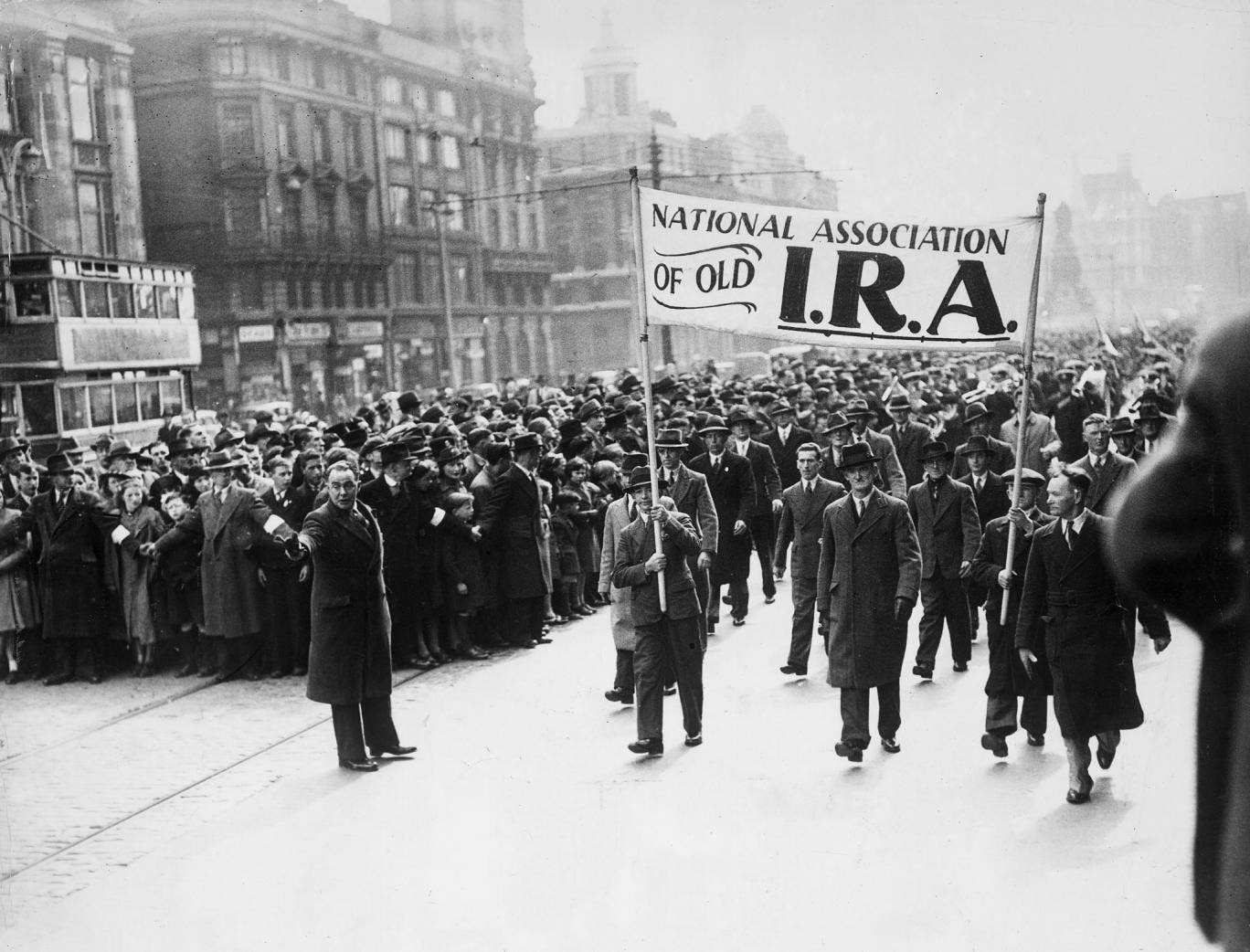10th April 1939: Crowds march through the streets of Dublin to commerate the Easter Rising, the armed uprising of Irish nationalists against British rule in Ireland.