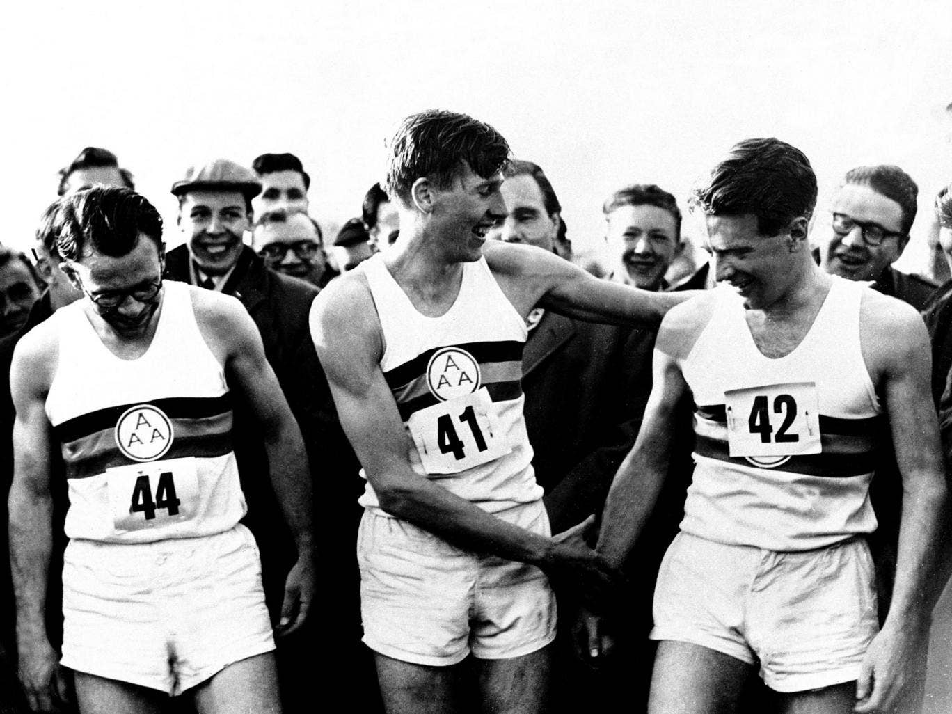 Roger Bannister celebrates with Chris Chataway in 1954 as he becomes the first man to run a sub-four minute mile