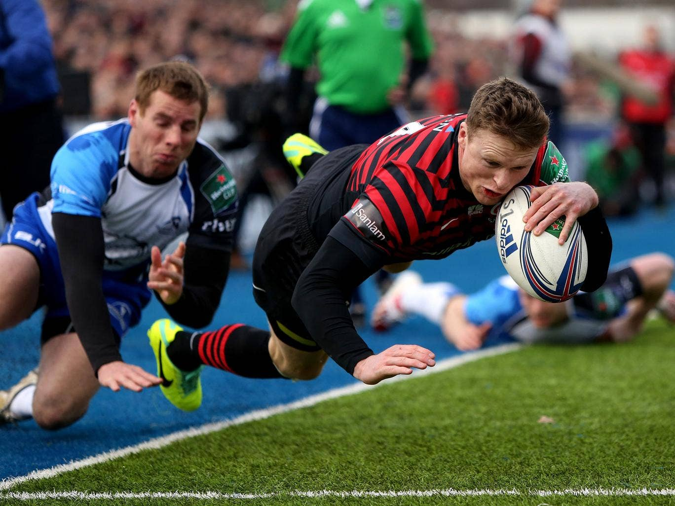 Saracens' Chris Ashton evades the tackle of Gavin Duffy to score the opening try