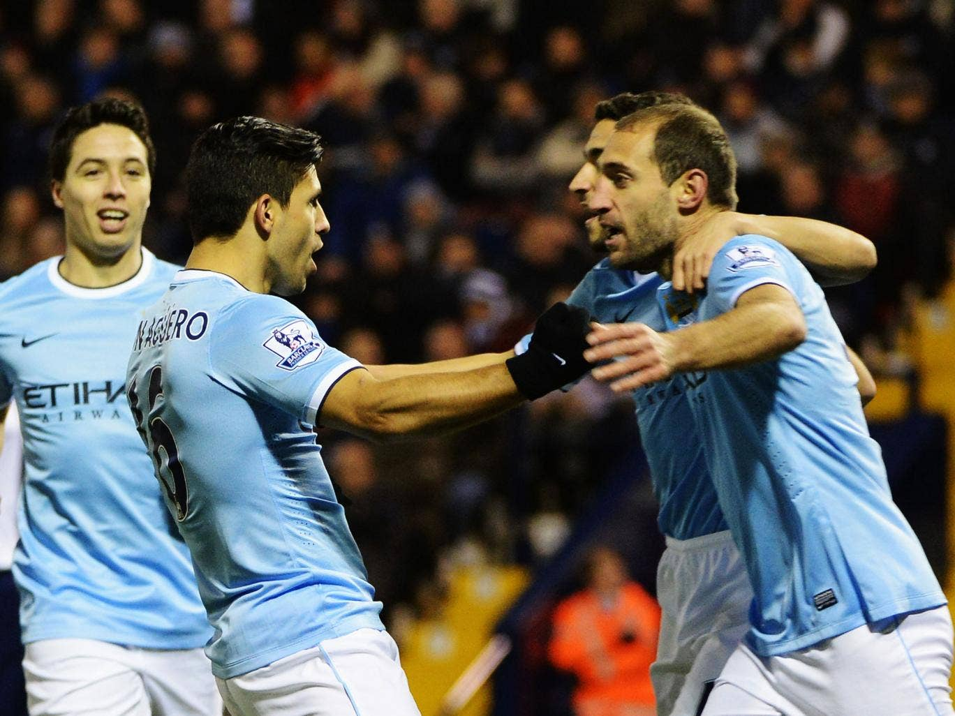 Sergio Aguero and Pablo Zabaleta celebrate after the striker scores for Manchester City