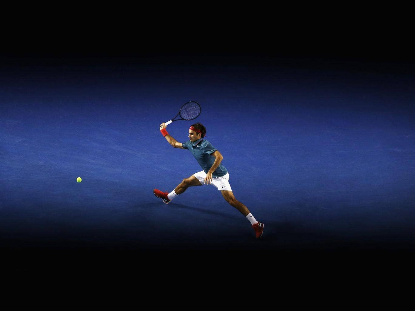 Roger Federer of Switzerland plays a forehand in his fourth round win against Jo-Wilfried Tsonga