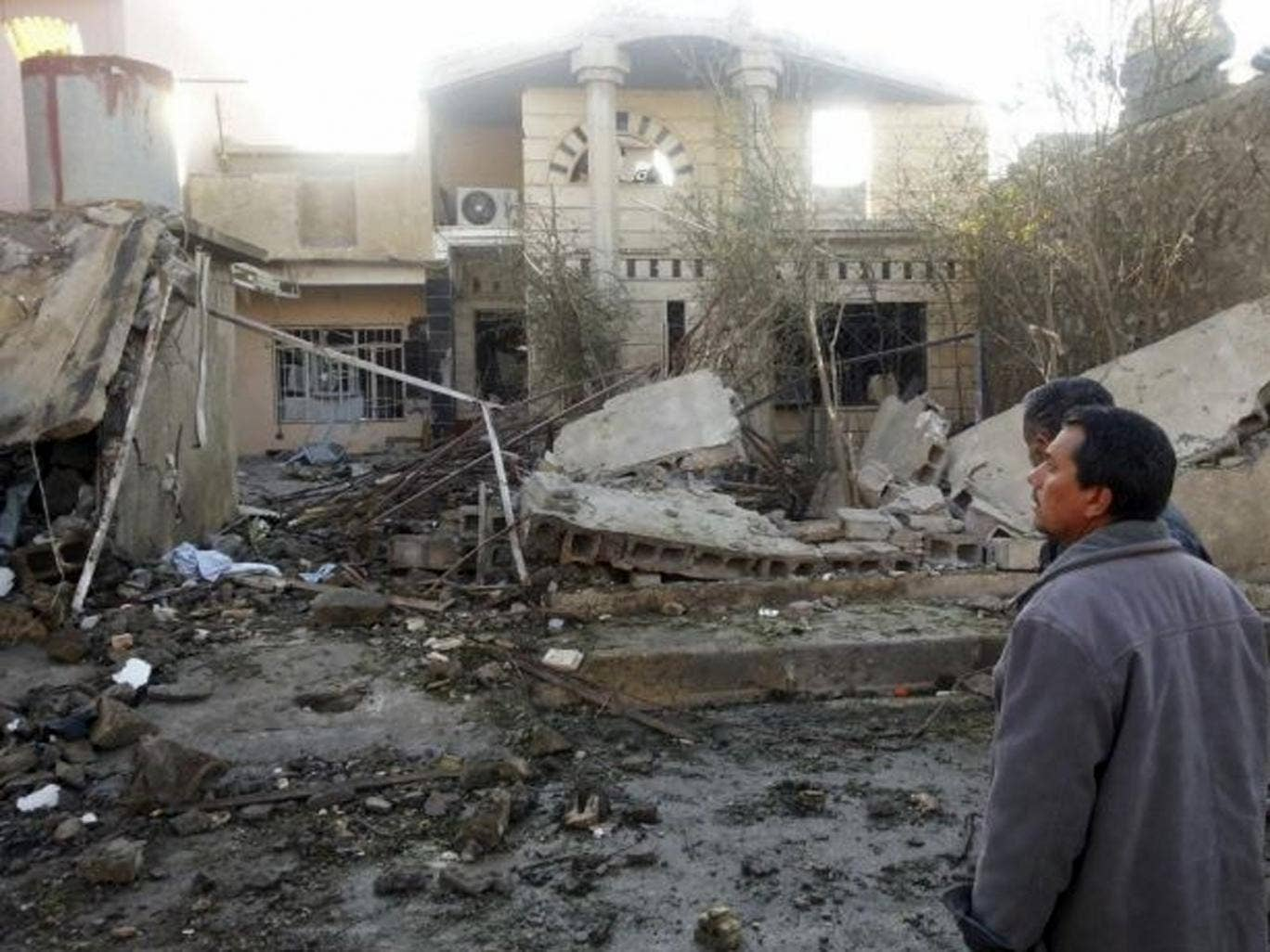 Civilians at the site of a car bomb attack in the town of Tuz Khurmatu, north of Baghdad