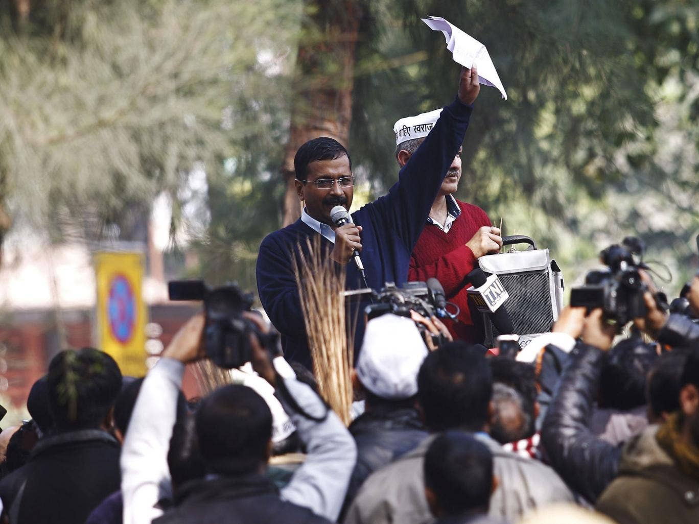 Delhi's Chief Minister Arvind Kejriwal addresses his supporters during a protest in New Delhi