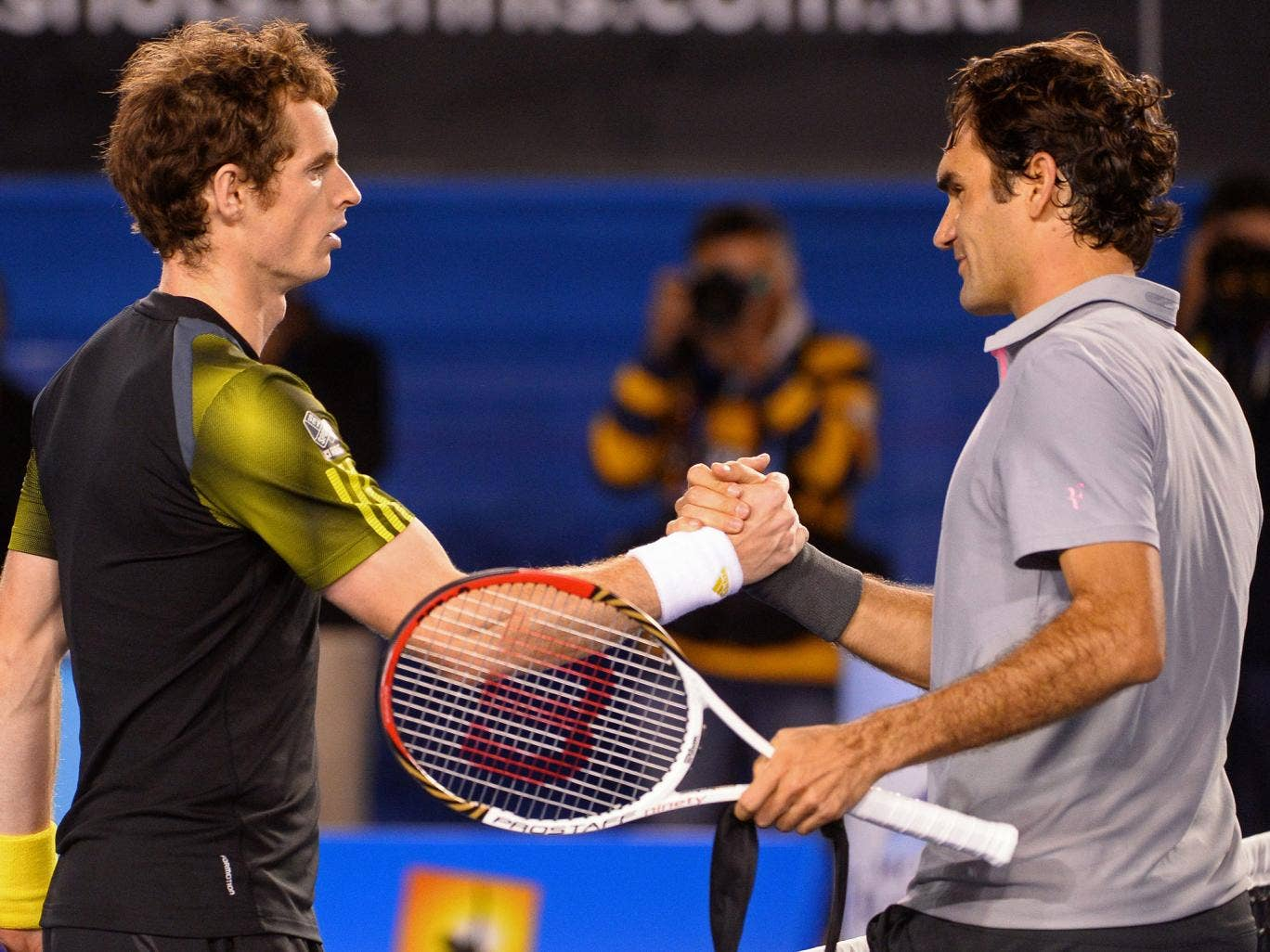 Andy Murray and Roger Federer pictured after their 2013 Australian Open semi-final