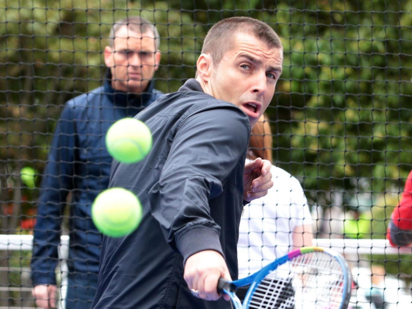 Liam Gallagher battles Aussie Open heatwave with freshly shaved head (and bomber jacket) in bizarre tennis-related PR stunt