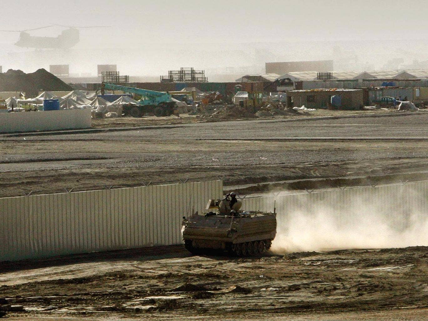 A British armored vehicle patrols on the periphery of the camp Bastion in southern Afghanistan in 2007