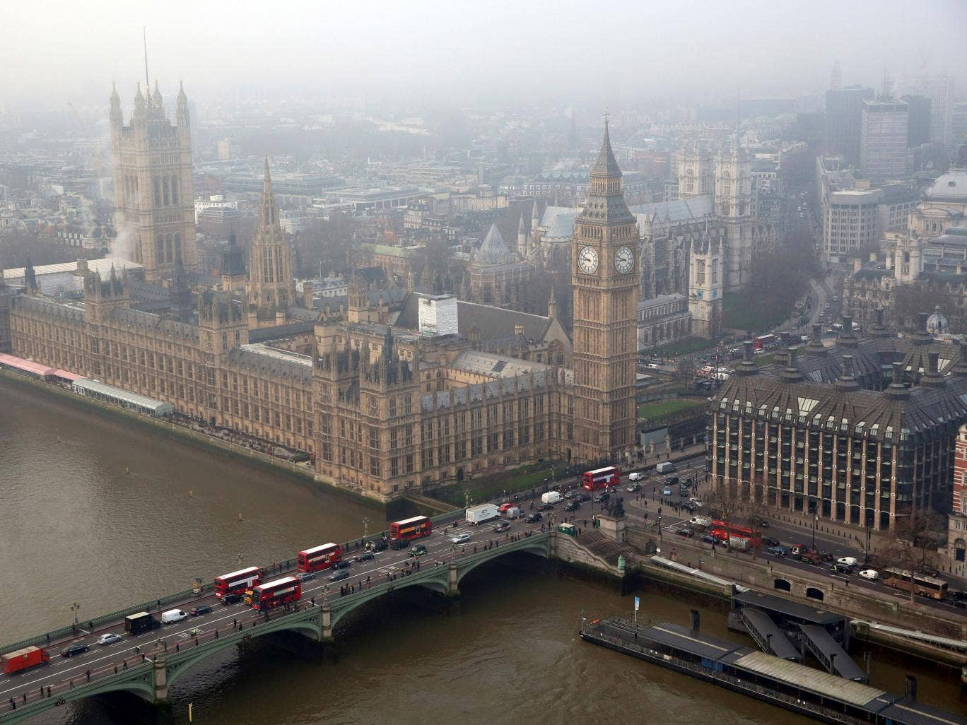 The Houses of Parliament and the river Thames are shrouded in early morning fog