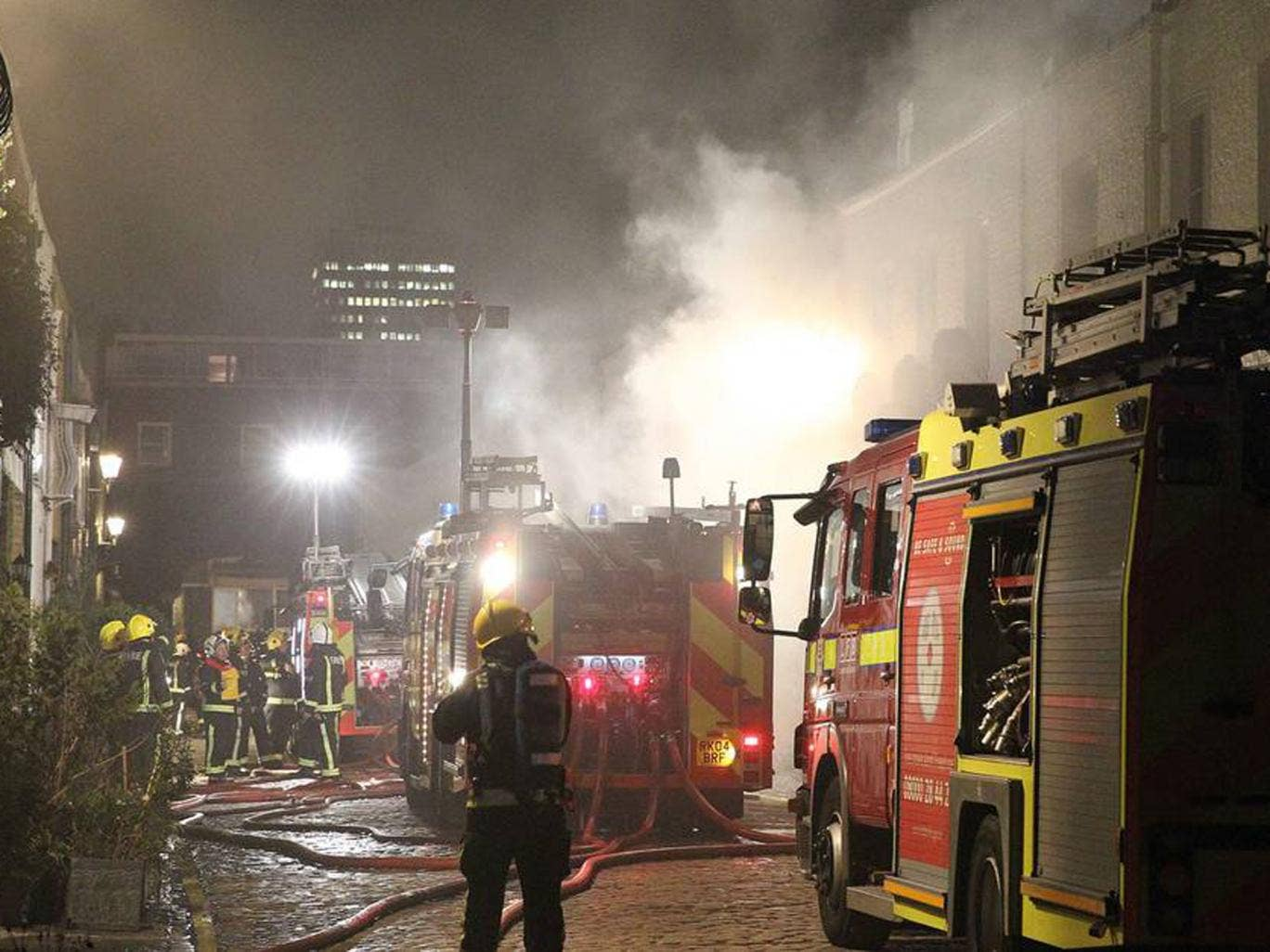 Emergency workers battle to contain the flames
