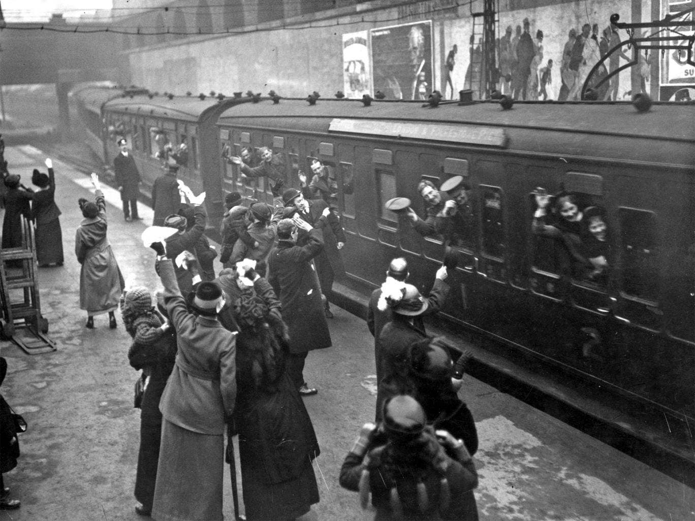 Soldiers waving good bye to loved ones as they leave Victoria Station in 1915