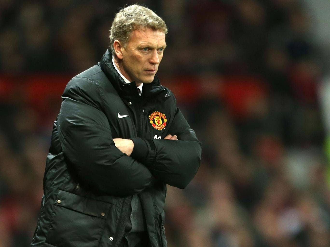 Manchester United manager David Moyes scowls during his side's League Cup defeat to Sunderland