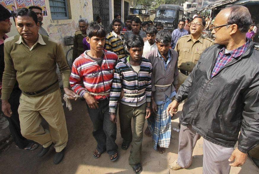 Indian police escort men accused of a gang-rape to a court at Birbhum district