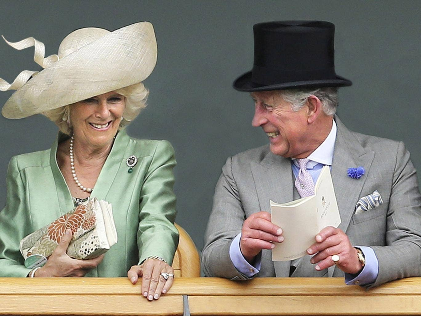 Camilla, Duchess of Cornwall and Prince Charles, Prince of Wales as they are seen viewing horses in the parade ring from the Royal Box on the second day of Royal Ascot in London, 2013