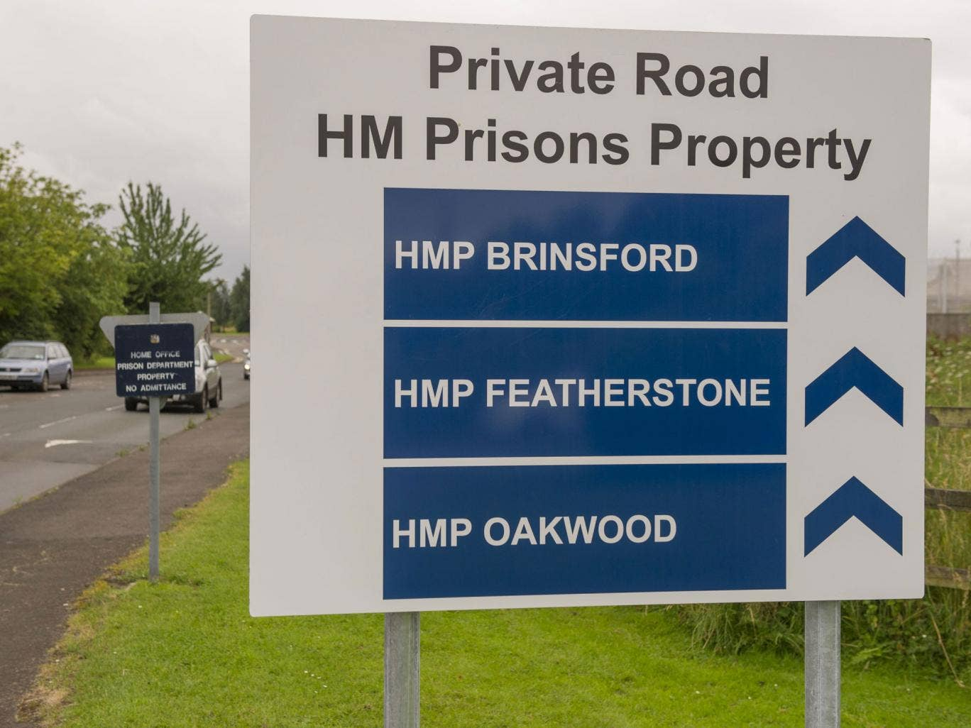 Road sign to the entrance of HMP Featherstone, HMP Brinsford and HMP Oakwood; a nine-hour disturbance at Oakwood prison has been described as a 'full scale riot'