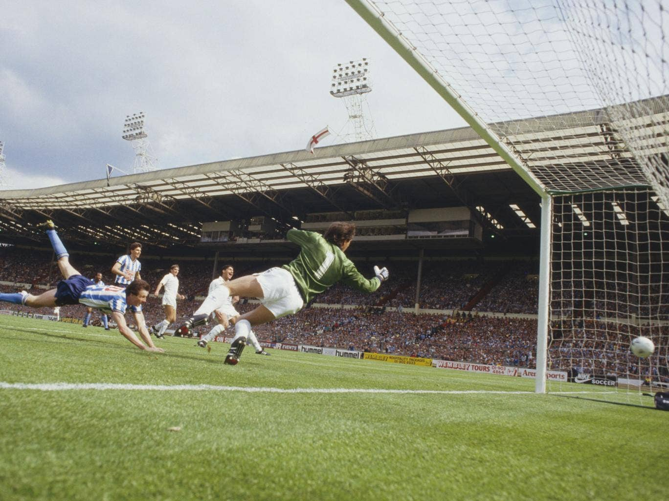 Keith Houchen heads Coventry's second goal past Tottenham goalkeeper Ray Clemence in the 1987 final