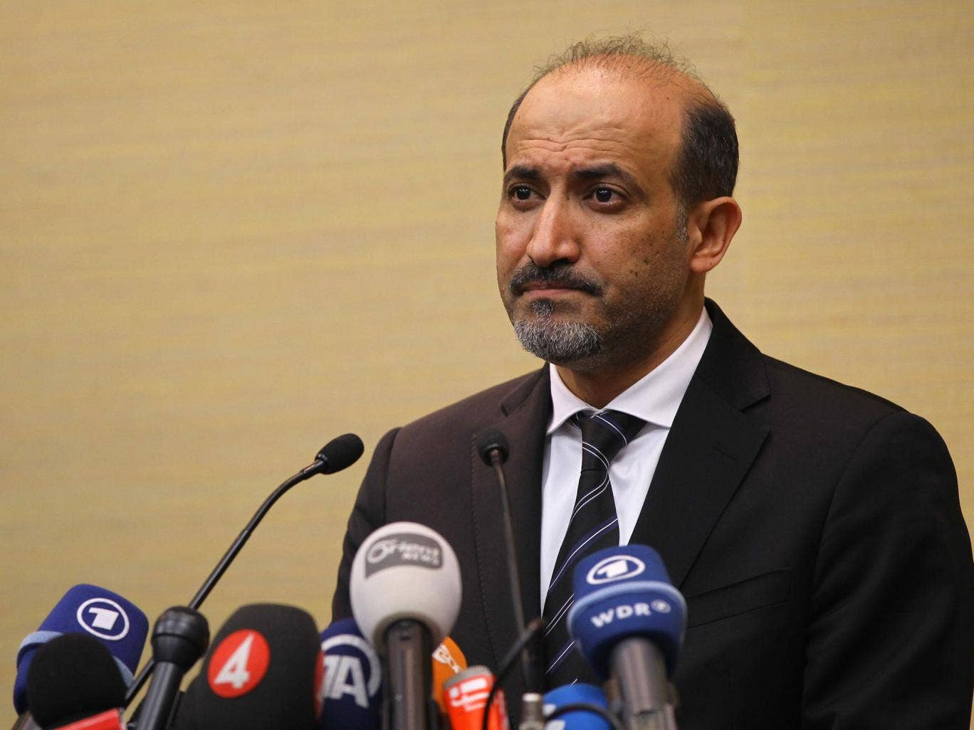 Ahmad al-Jarba, leader of the Syrian National Coalition (SNC), speaks to the press in Geneva, Switzerland