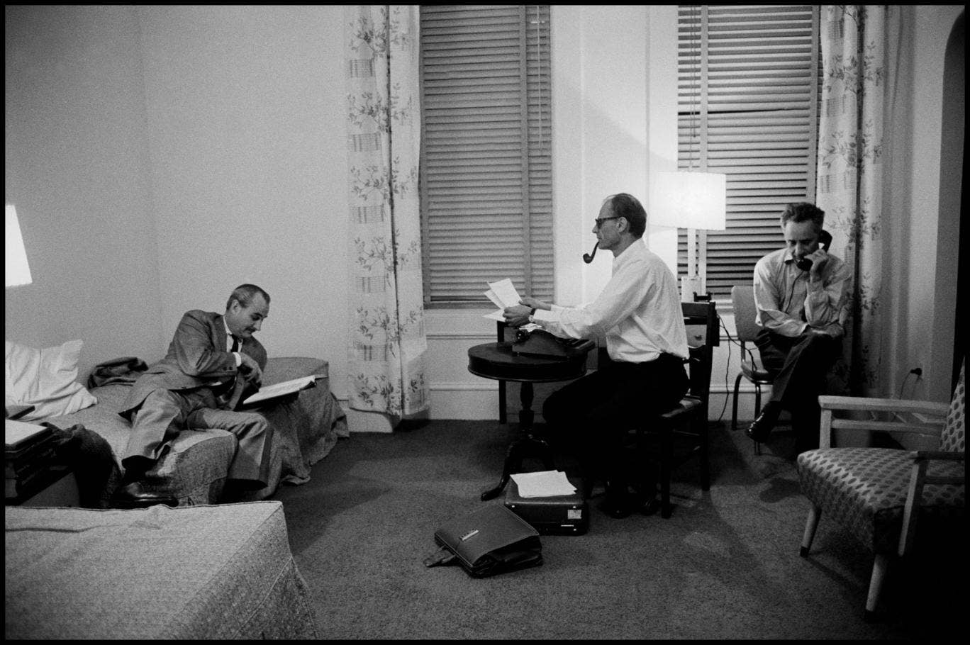 Robert Whitehead, Arthur Miller and Elia Kazan working on the production of the play 'After the Fall' in the Chelsea Hotel, 1963