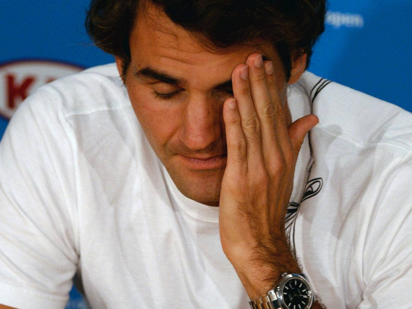 Roger Federer talks to the press following his semi-final defeat to Nadal