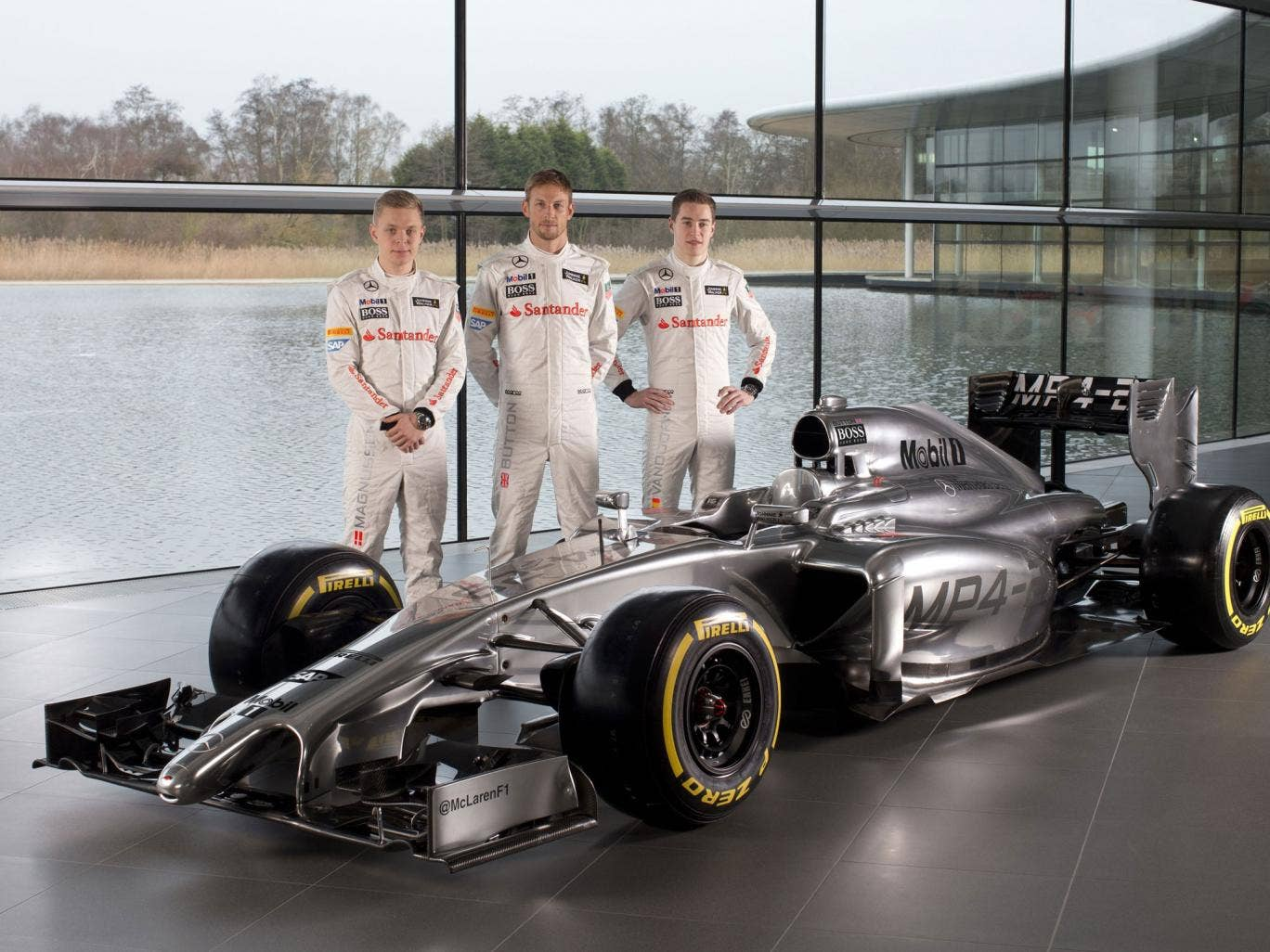 McLaren drivers (left to right) Kevin Magnussen, Jenson Button and Stoffel Vandoorne at the launch of the new MP4-29 car at their base in Woking