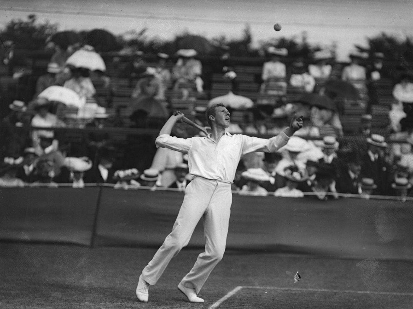 July 1908: Anthony Wilding of New Zealand in action during the tennis championships at Wimbledon