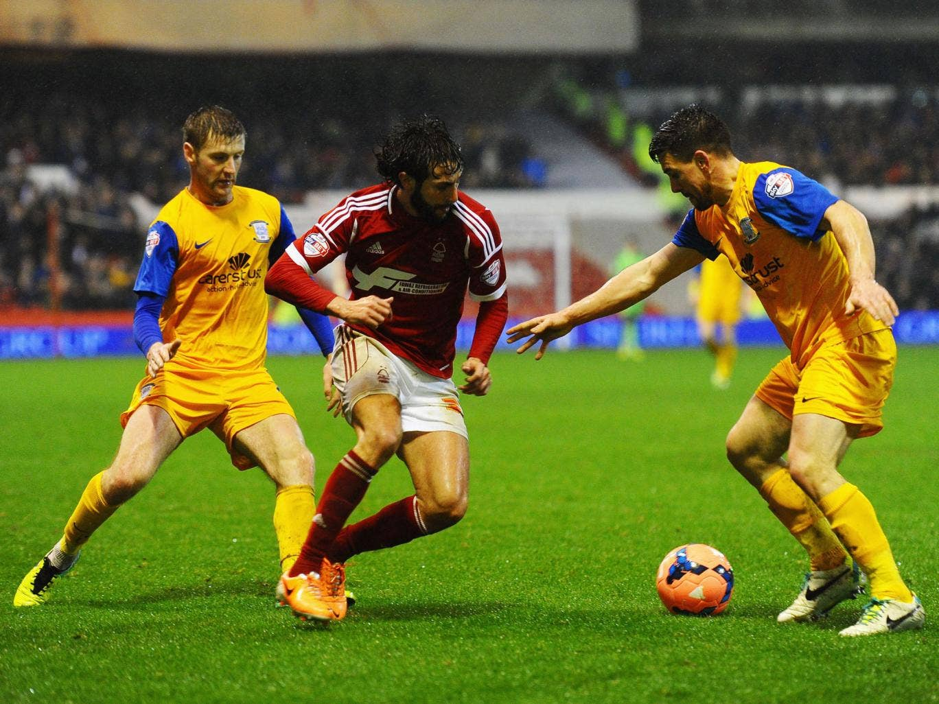 Djamel Abdoun of Nottingham Forest, centre, takes on Paul Gallagher, left, and David Buchanan of Preston North End