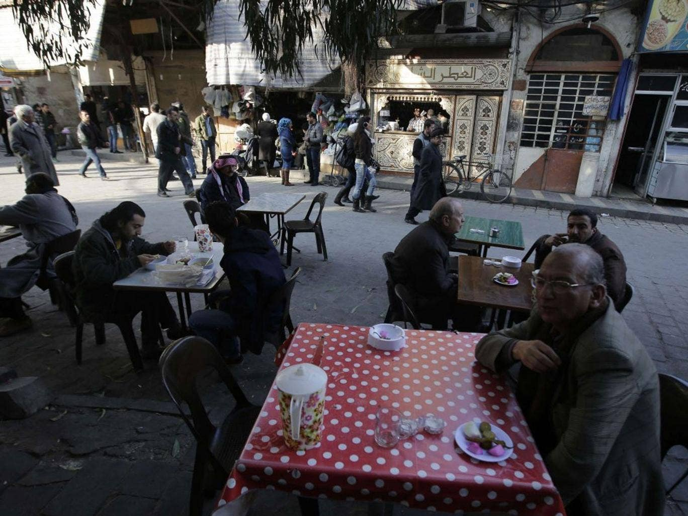 Table talk: A veneer of normality survives in some parts of Damascus