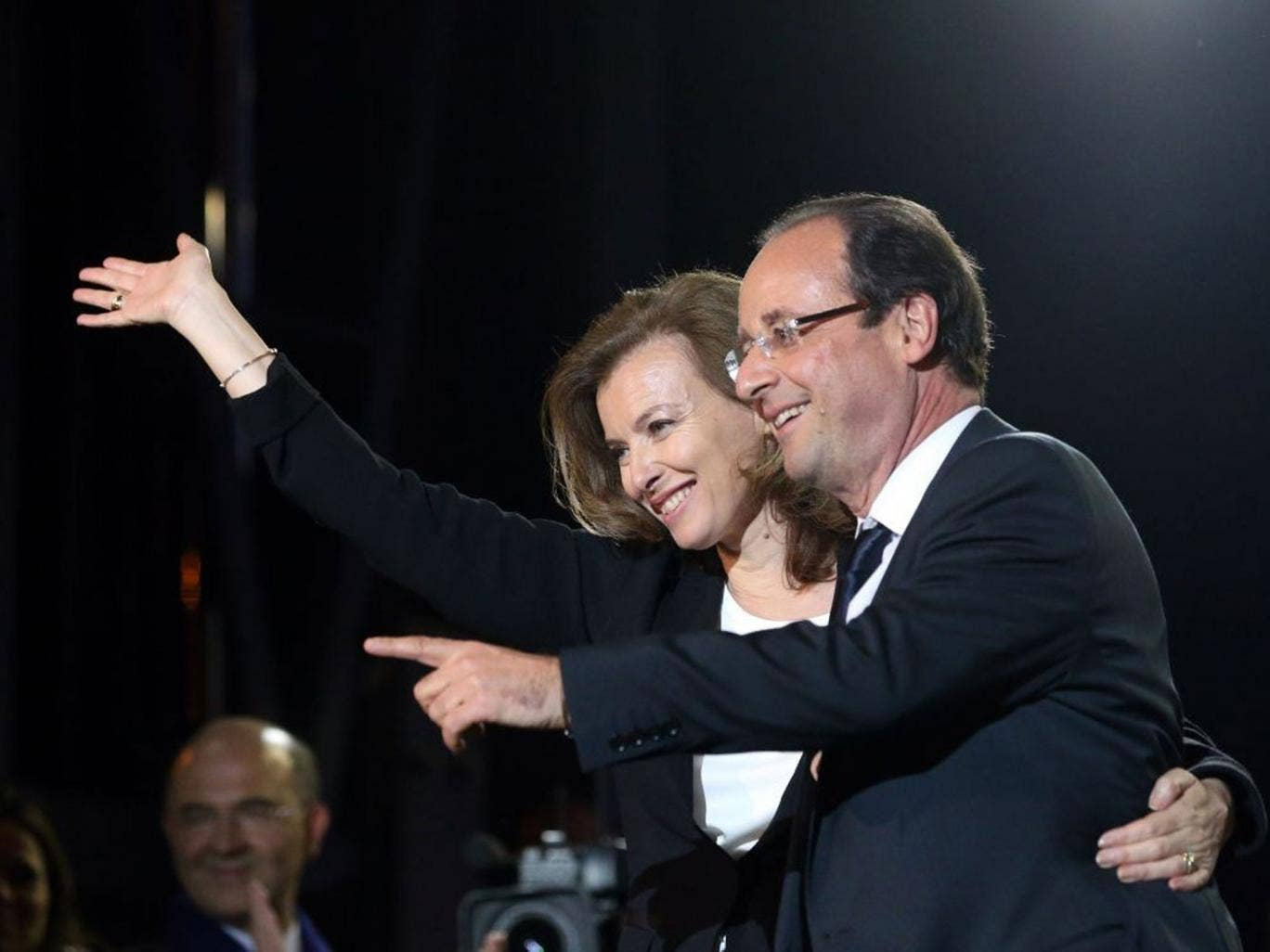 Francois Hollande and his then partner Valerie Trierweiler greet thousands of gathered supporters at Place de la Bastille after victory in French Presidential Elections on May, 2012
