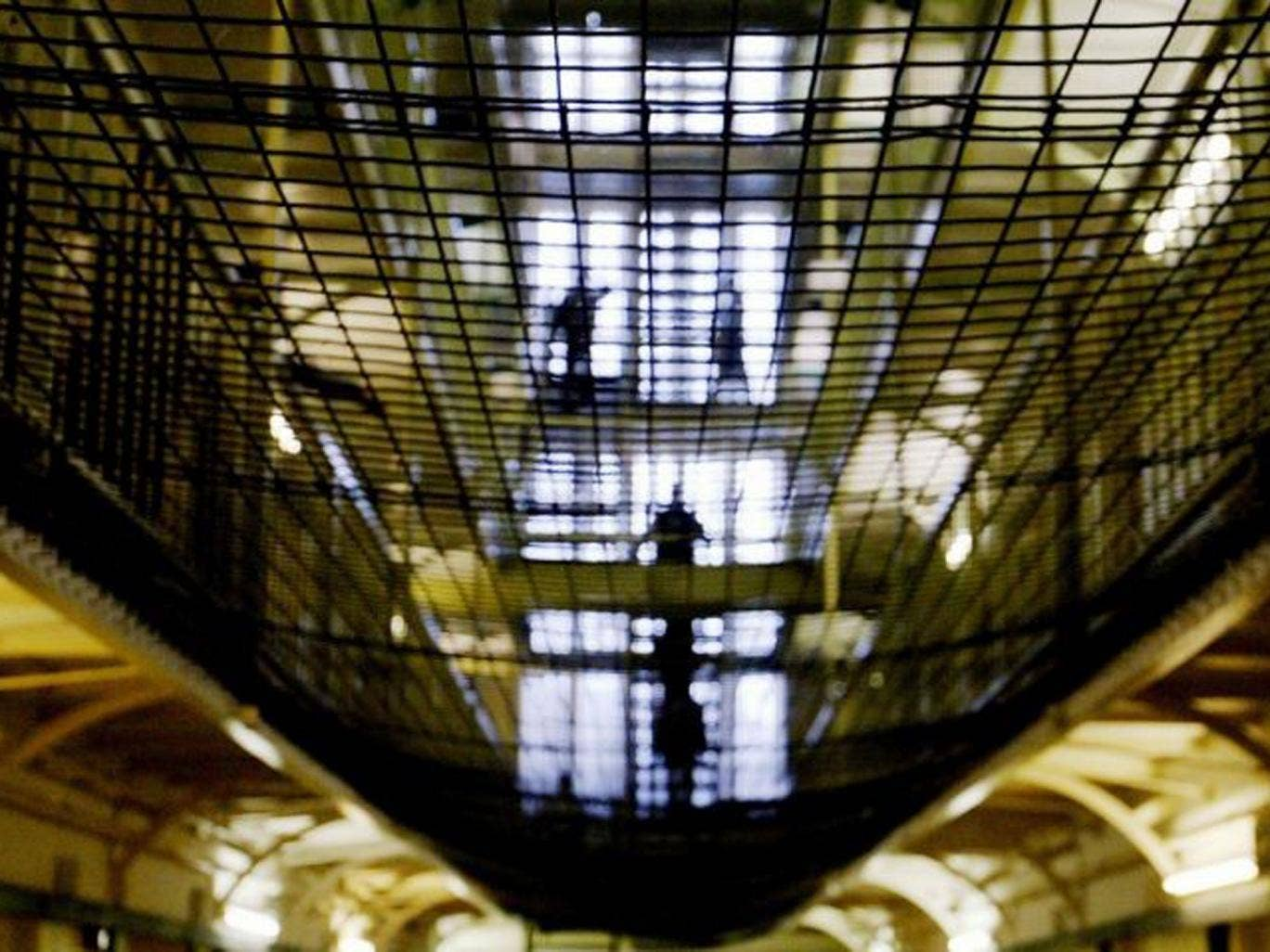 Behind bars: Reformed prisoners could be held in jail longer than is necessary