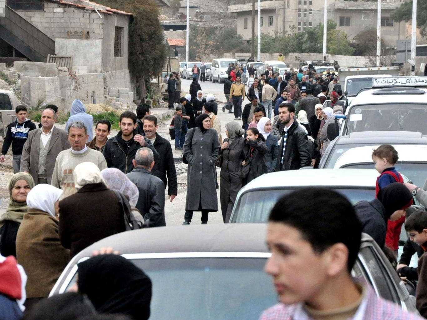 Families, who had fled their homes due to fighting, return to their houses in the Barzeh neighbourhood of Damascus