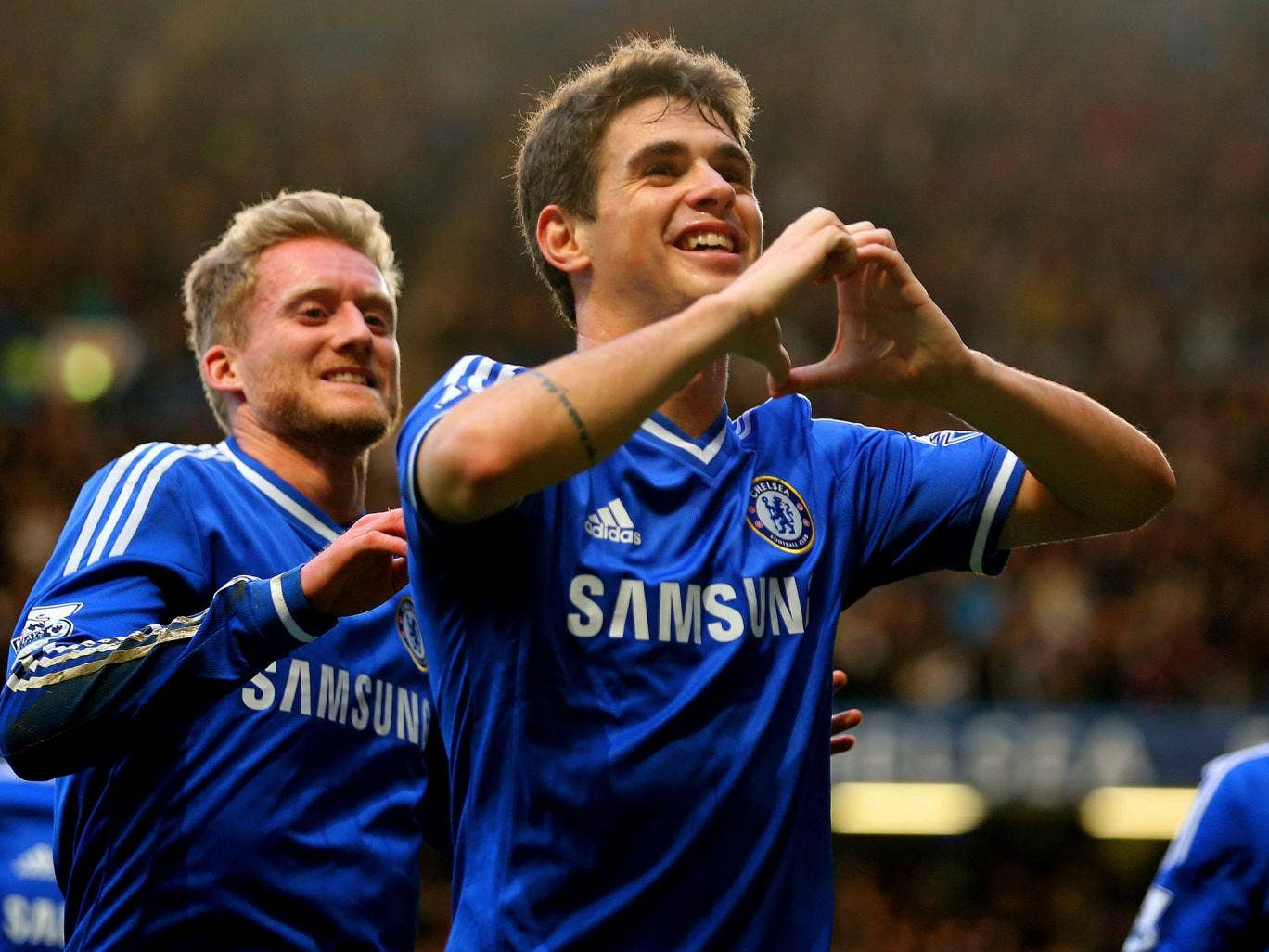 Oscar (right) celebrates his winner with Andre Schurrle
