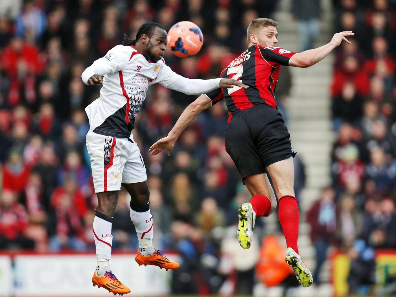 Liverpool's Victor Moses, left, fights for the ball with AFC Bournemouth's Simon Francis