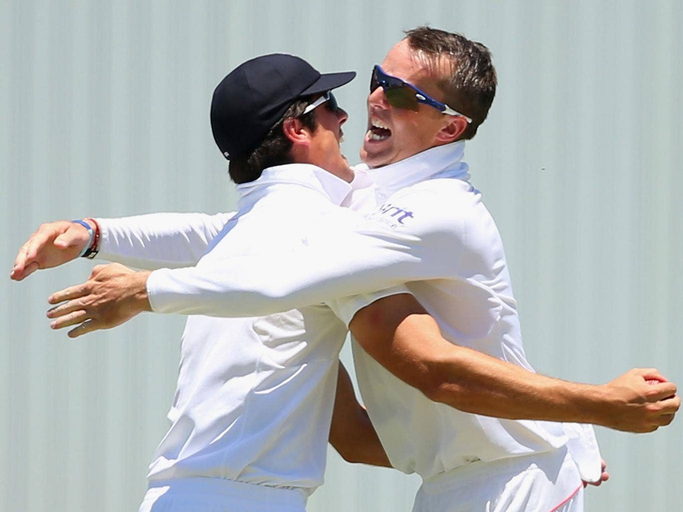 Alastair Cook and Graeme Swann celebrate during the 2013-14 Ashes Series in Australia