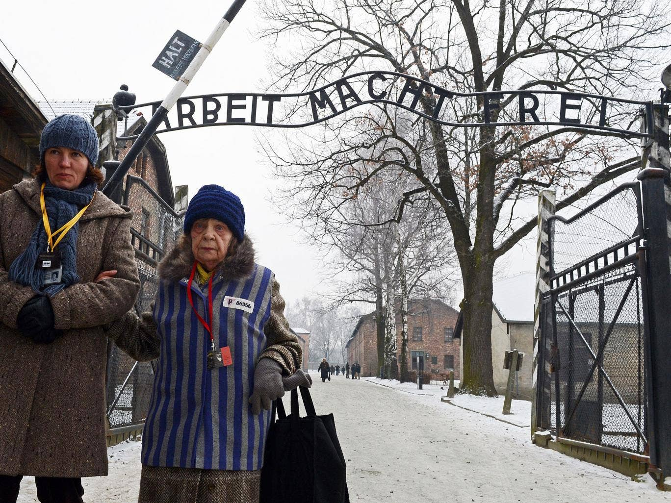 Former concentration camp prisoners attend a ceremony at the memorial site of the former Nazi concentration camp Auschwitz-Birkenau in Oswiecim, Poland, on Holocaust Day, January 27, 2014. The ceremony took place 69 years after the liberation of the death
