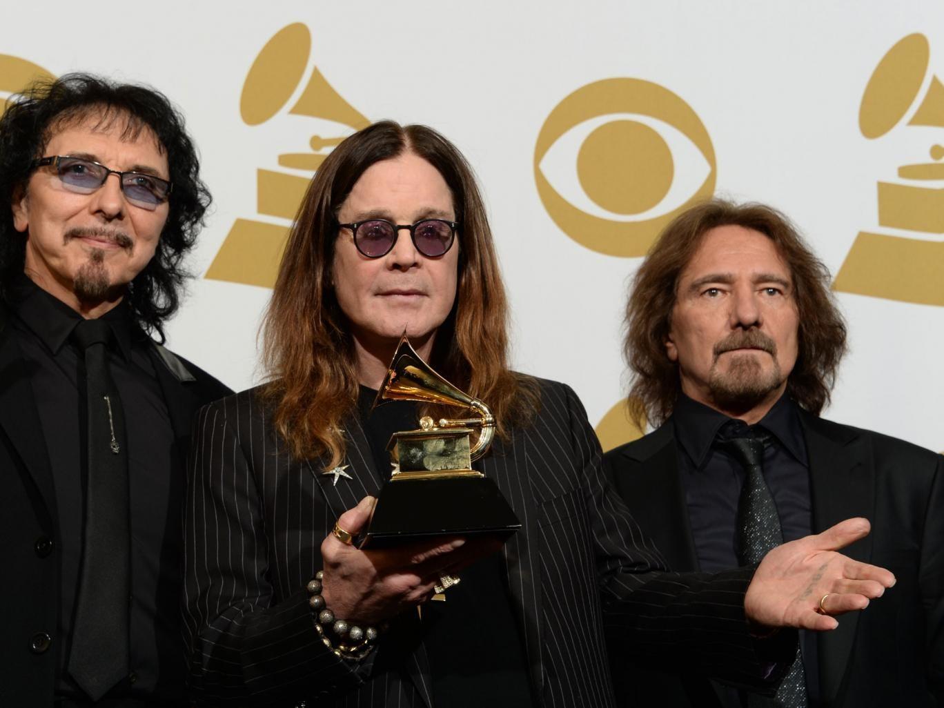 Ozzy Osborne with Black Sabbath's Grammy Award for Hard Rock/Metal Performance with God Is Dead