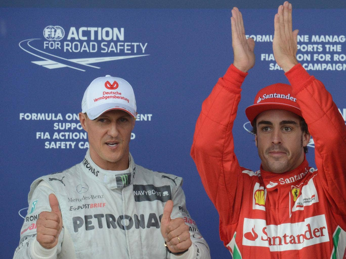 Michael Schumacher and Fernando Alonso pose together