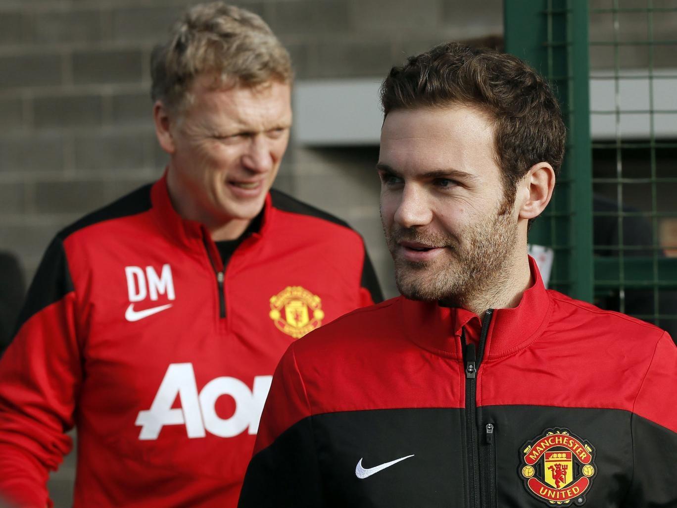 Juan Mata (right) and David Moyes arrive at Carrington training complex on Monday