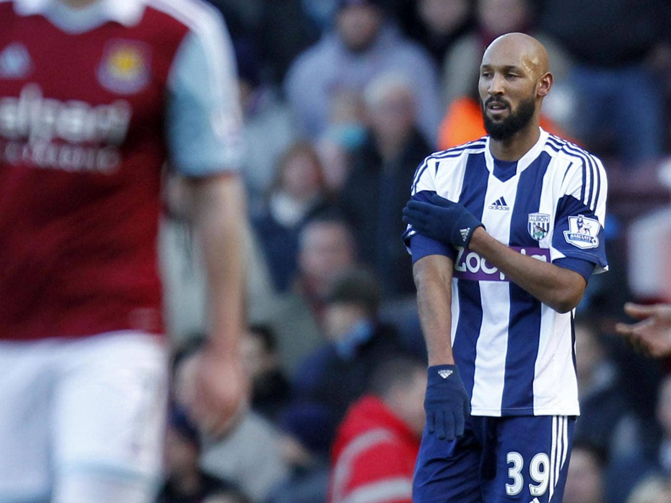 West Bromwich Albion's French striker Nicolas Anelka gestures as he celebrates scoring their second goal against West Ham United